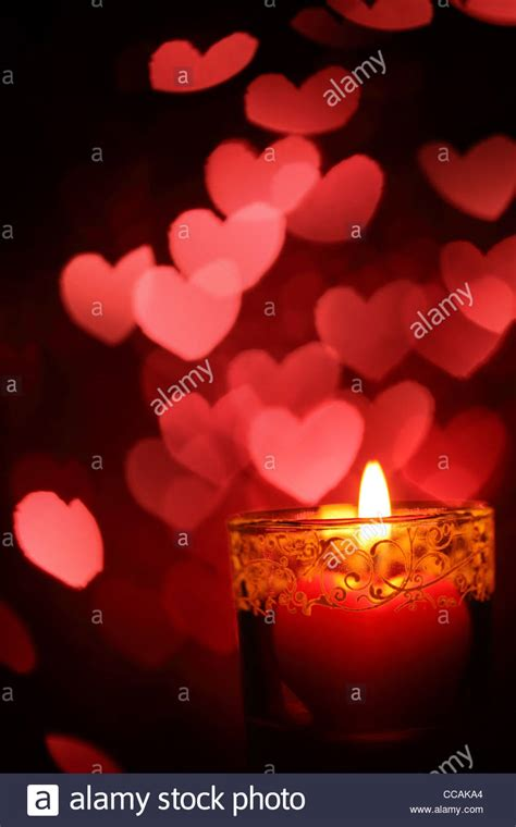 Burning heart-shape candles for Valentine's Day Stock